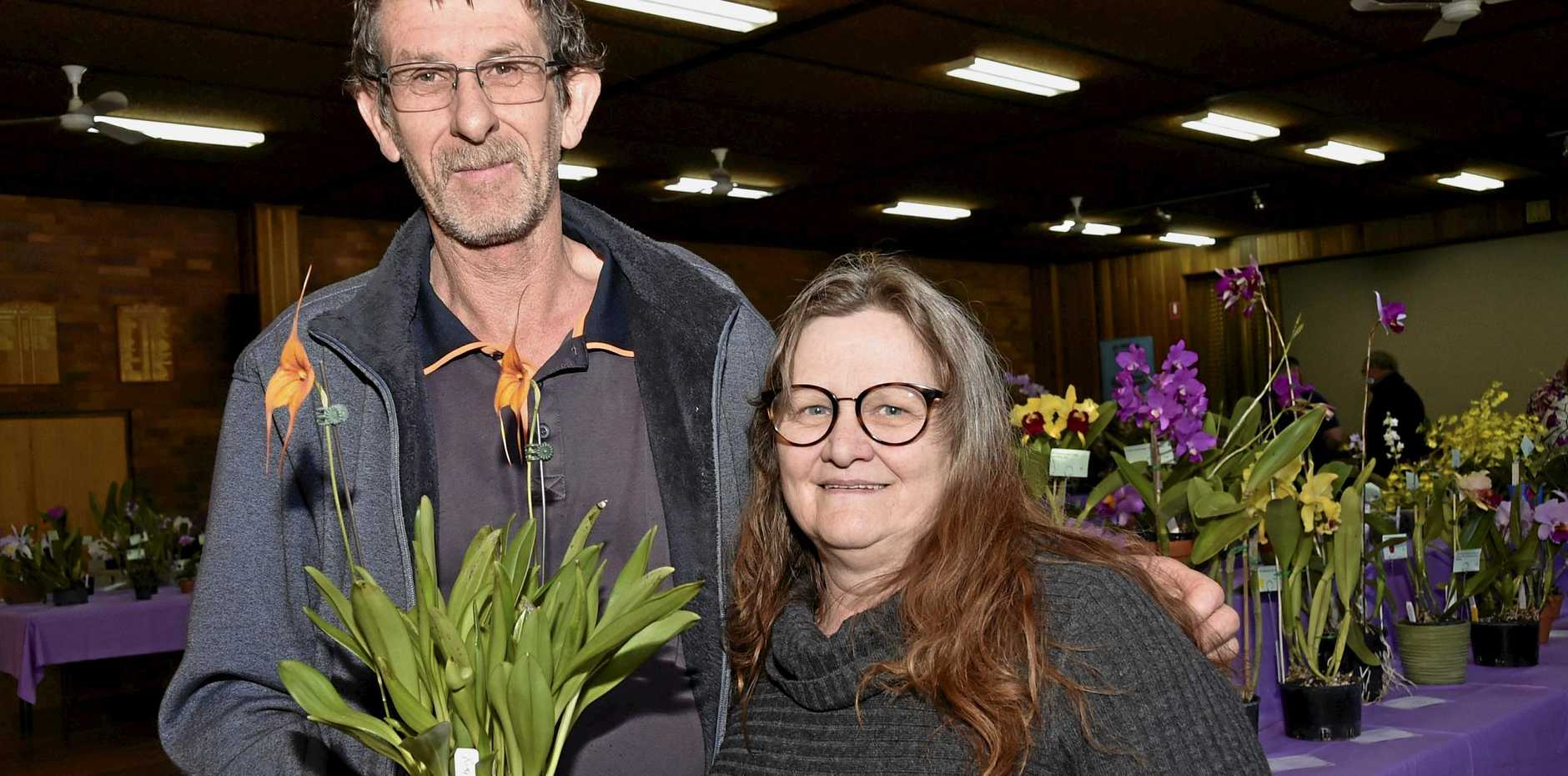 Steve and Sonia Pope with the champion orchid of the show.