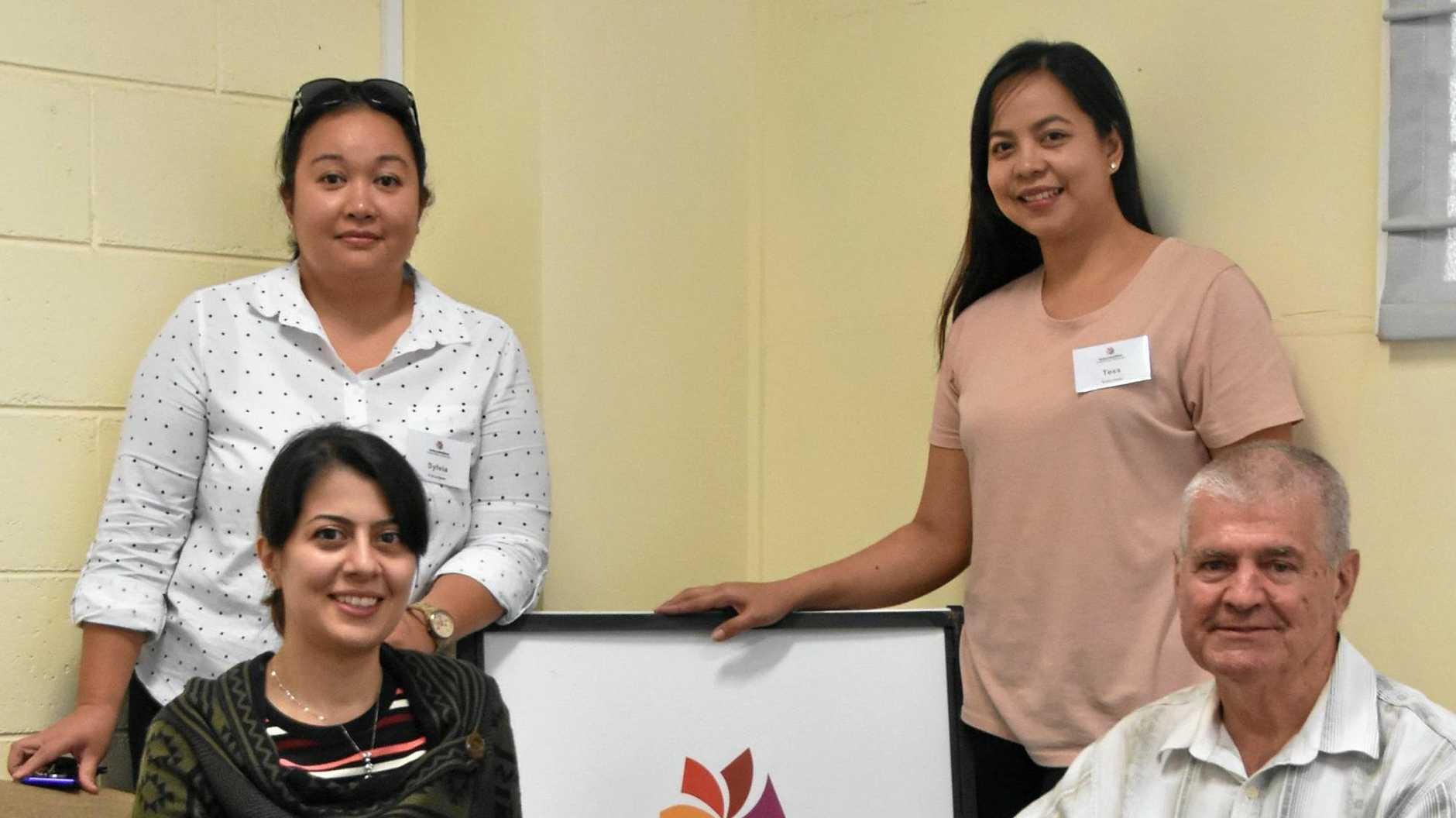 HELPING HAND:  Elmira Esfahani (front left) with volunteers Sylvia Too, Tess Castillo and Graham Dingley .