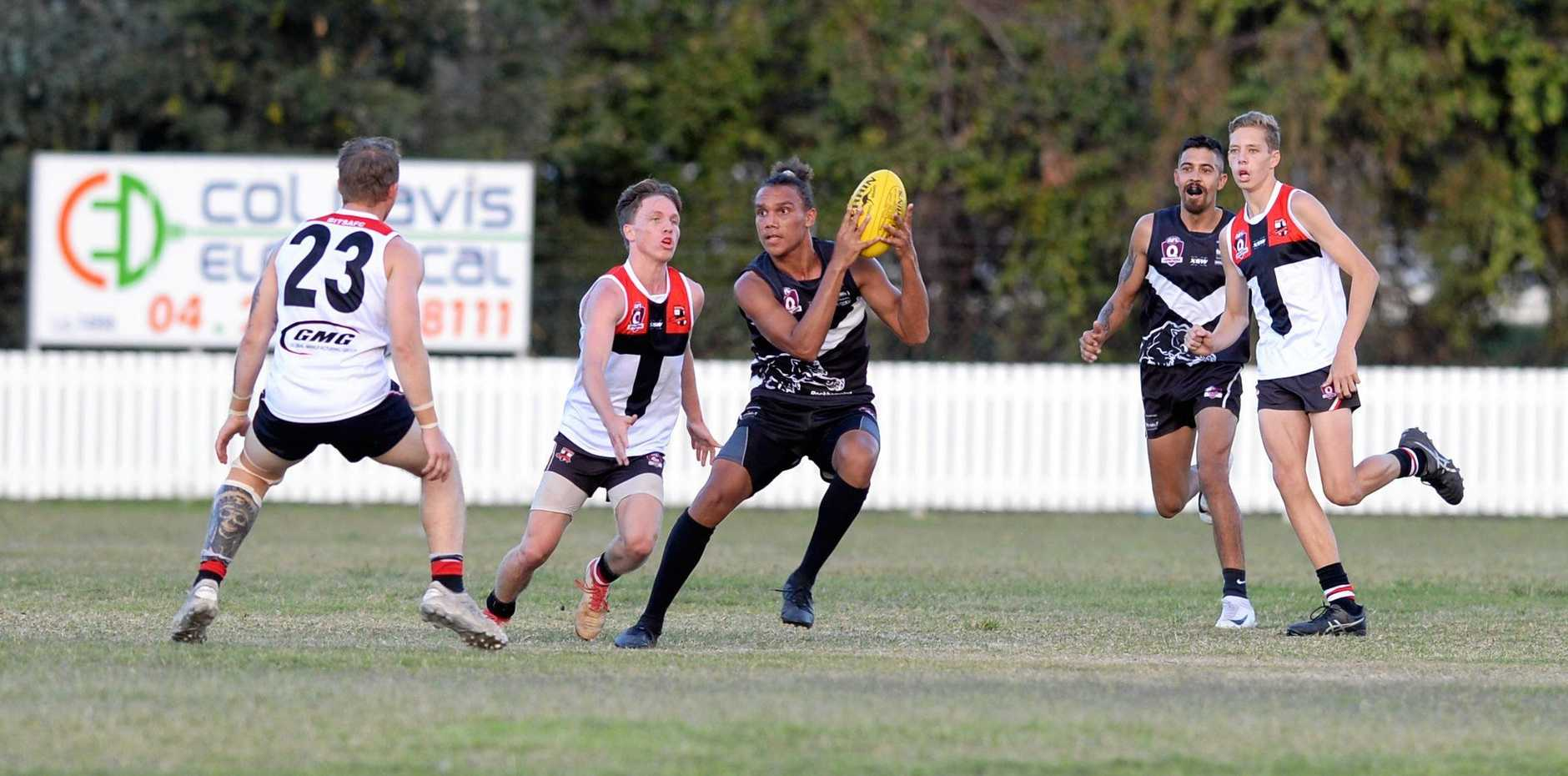 TAKING CHARGE: Panthers' Xavier Mason grabs possession in the AFL Capricornia clash against BITS at the Rockhampton Cricket Ground on Saturday.