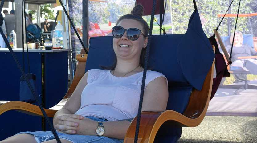 RELAXED CUSTOMER: Nicole Van Tonder tests a Cloud 9 hanging chair at the Mackay Home Show and Caravan, Camping Expo.