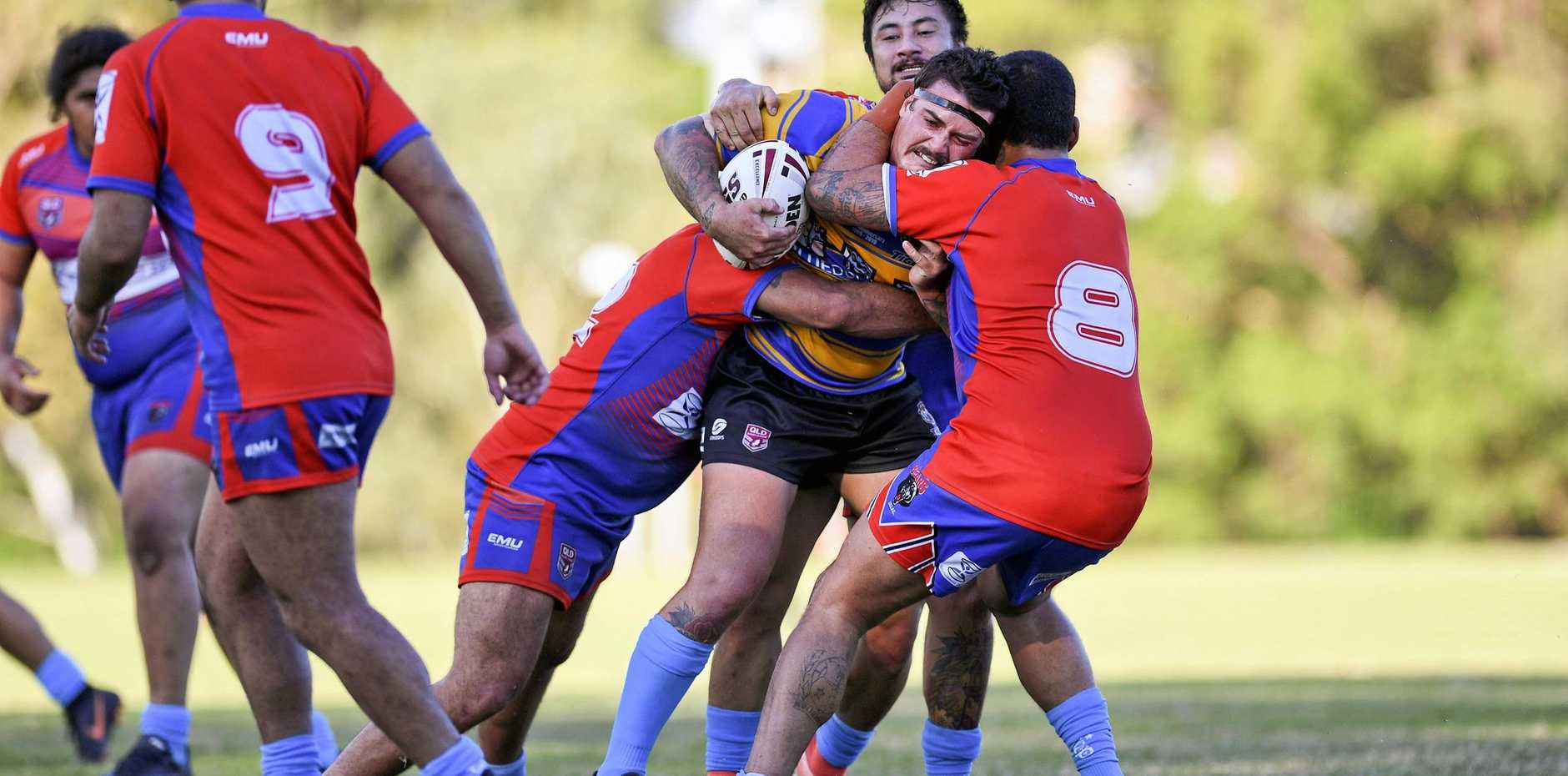 DETERMINED DEFENCE: The Redbank Plains tacklers stop Norths forward Blake Olive in Sunday's A-Grade match at Keith Sternberg Oval. The Bears beat the Tigers 40-12.
