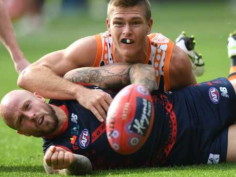 Nathan Jones under pressure from Giant Adam Tomlinson.
