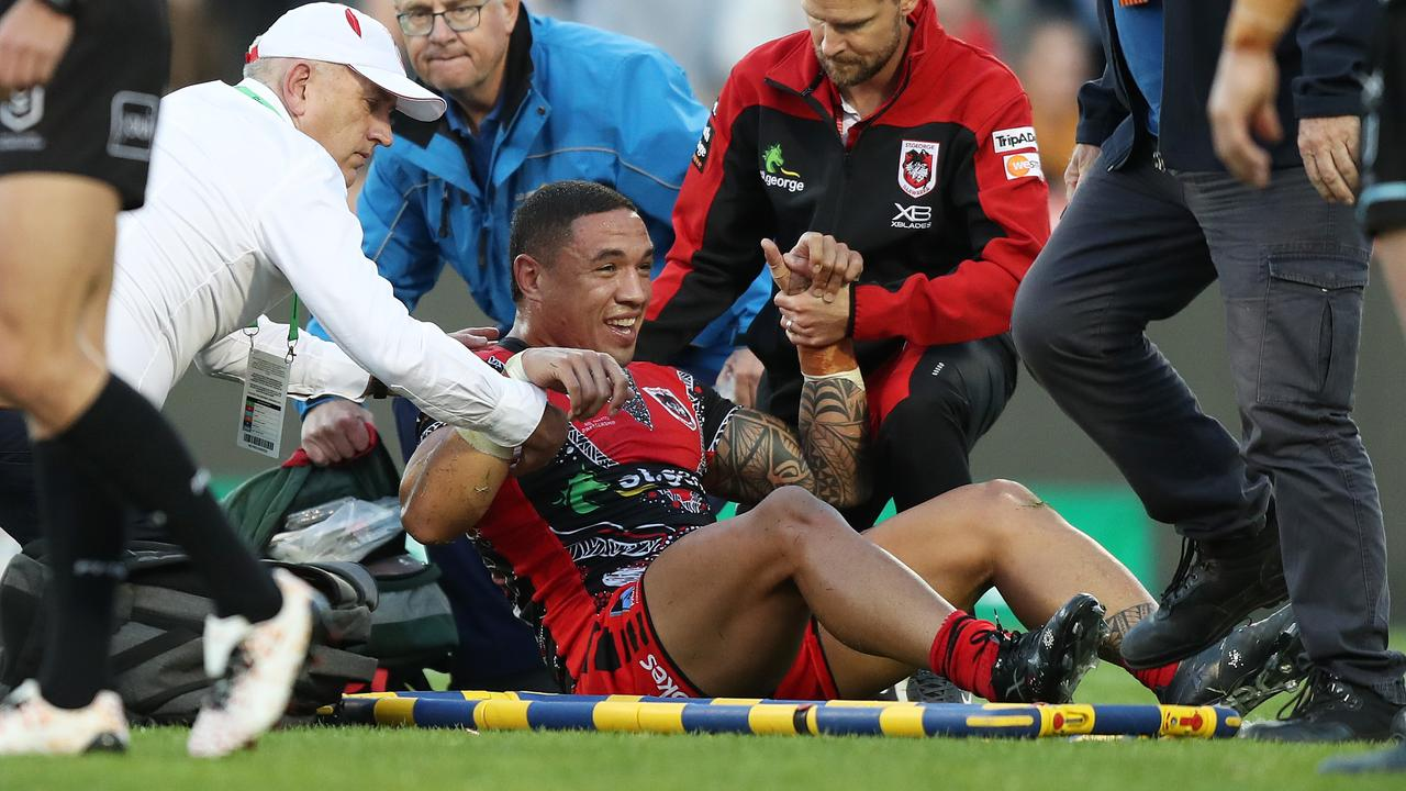 Frizell is helped up after being knocked out. Picture: Brett Costello