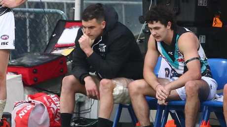 Tom Rockliff finished the match on the bench with a hamstring injury. Picture: Getty Images