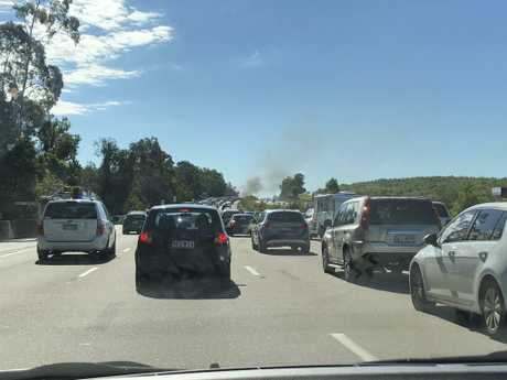 A car on fire on the M1 near Exit 49 on the Gold Coast. Photo: Amanda Robbemond