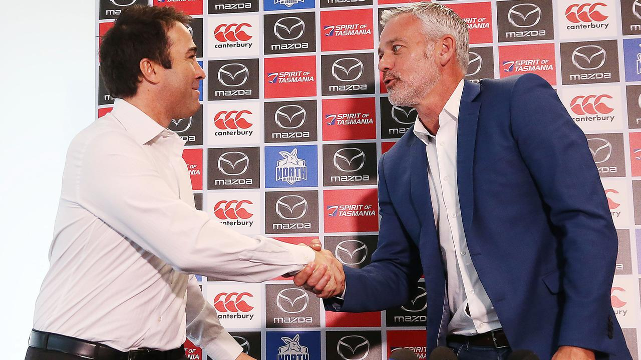 Brad Scott and Ben Buckley shake hands before parting ways. Picture: Getty
