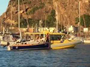 Yacht under tow in Rosslyn Bay Marina