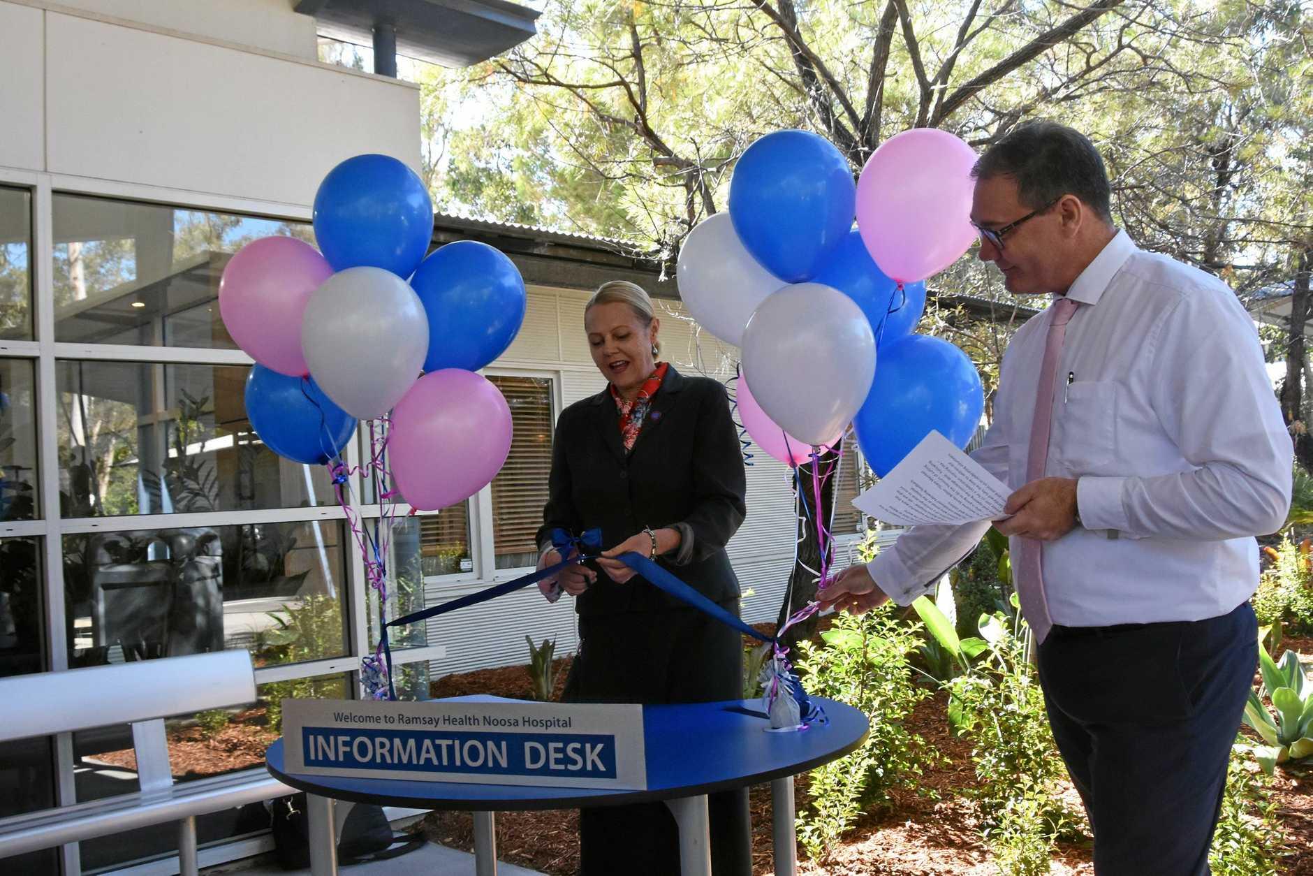 Noosa MP Sandy Bolton cuts the ribbon for the new volunteer concierge desk at Noosa Hospital.