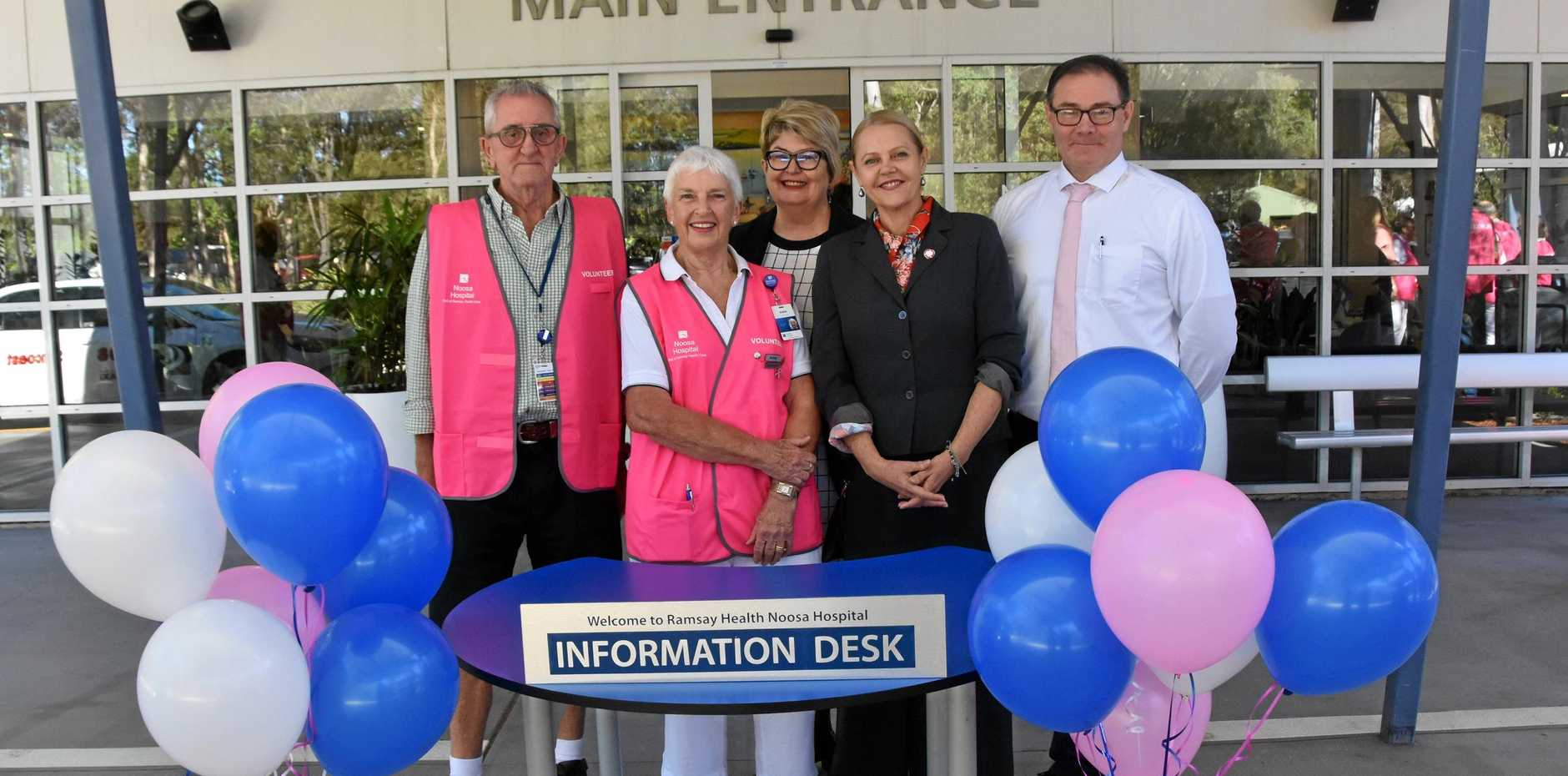 CELEBRATED: Noosa Hospital volunteers Patrick Woods and Anne Smith with director of clinical services Judy Beazley, MP Sandy Bolton and hospital chief executive Shane Mitchell.