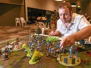 Age of Sigmar enthusiasts fight on the tabletop