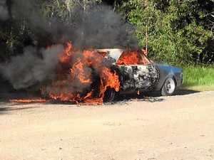 UP IN FLAMES: Police investigate classic car blaze