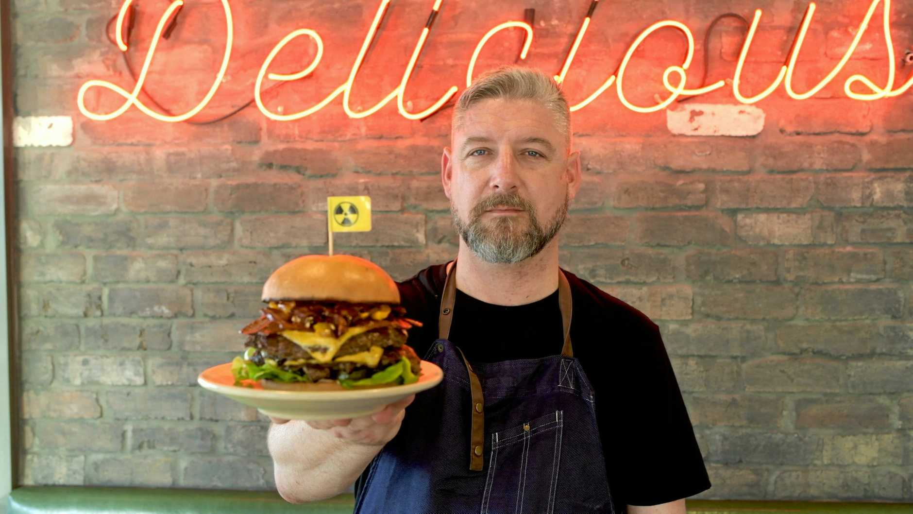 Officially the most popular burger in Burger Urge's history, the Double Decker Death Wish. Head Chef Joel Chrystal.