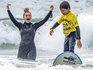 'Hooked for life': Riding high in perfect Mudjimba surf