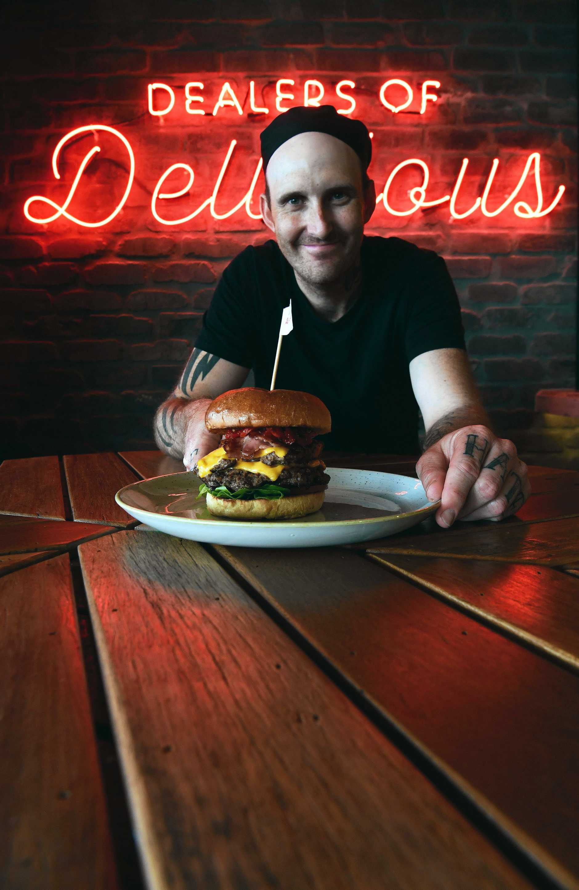BURGER URGE: Store manager Justin Last with the Double Decker Death Wish.