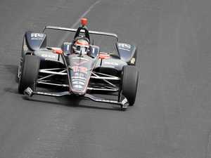 Power overcomes penalty flag at Indy 500