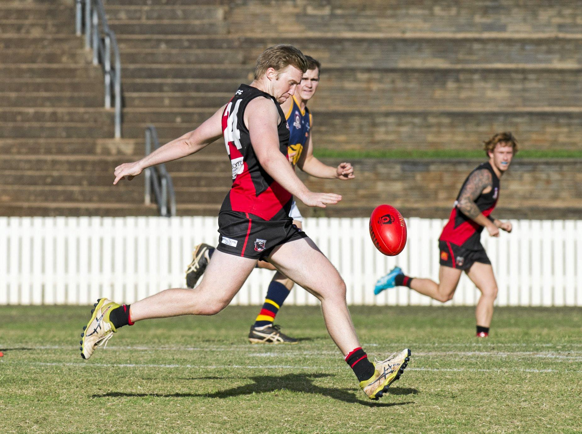 SWEET CONTACT: Alexander Kratzmann prepares to launch the ball downfield for South Toowoomba.