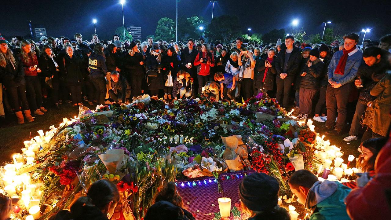 Mourners pay their respects during a vigil held in memory of Eurydice Dixon, at Princess Park in June 2018. Picture: Michael Dodge/Getty Images