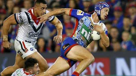 Kalyn Ponga makes a break for the Knights against the Roosters. Picture: AAP