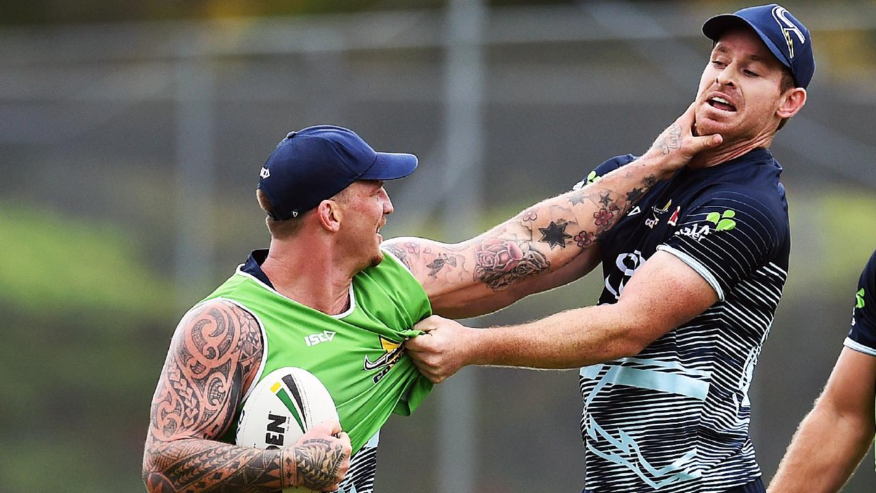 North Queensland Cowboys training from the Townsville Sports Reserve. Josh McGuire palms off Michael Morgan. Picture: Zak Simmonds