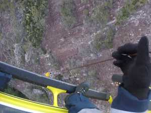Stranded hiker winched to safety from mountain ledge
