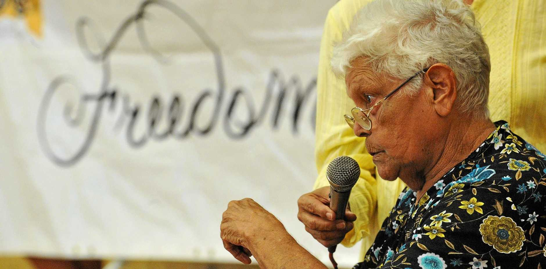 The late Aunty Pauline Gordon speaks to the crowd at the gathering for the Freedom Ride held at Grafton High School in 2011. Aunty Pauline was a member of the Stolen Generation. INSET: Early image from The Cootamundra Domestic Training Home for Aboriginal Girls, Bimbadeen, where Aunty Pauline was sent as an eight-year-old with her siblings.