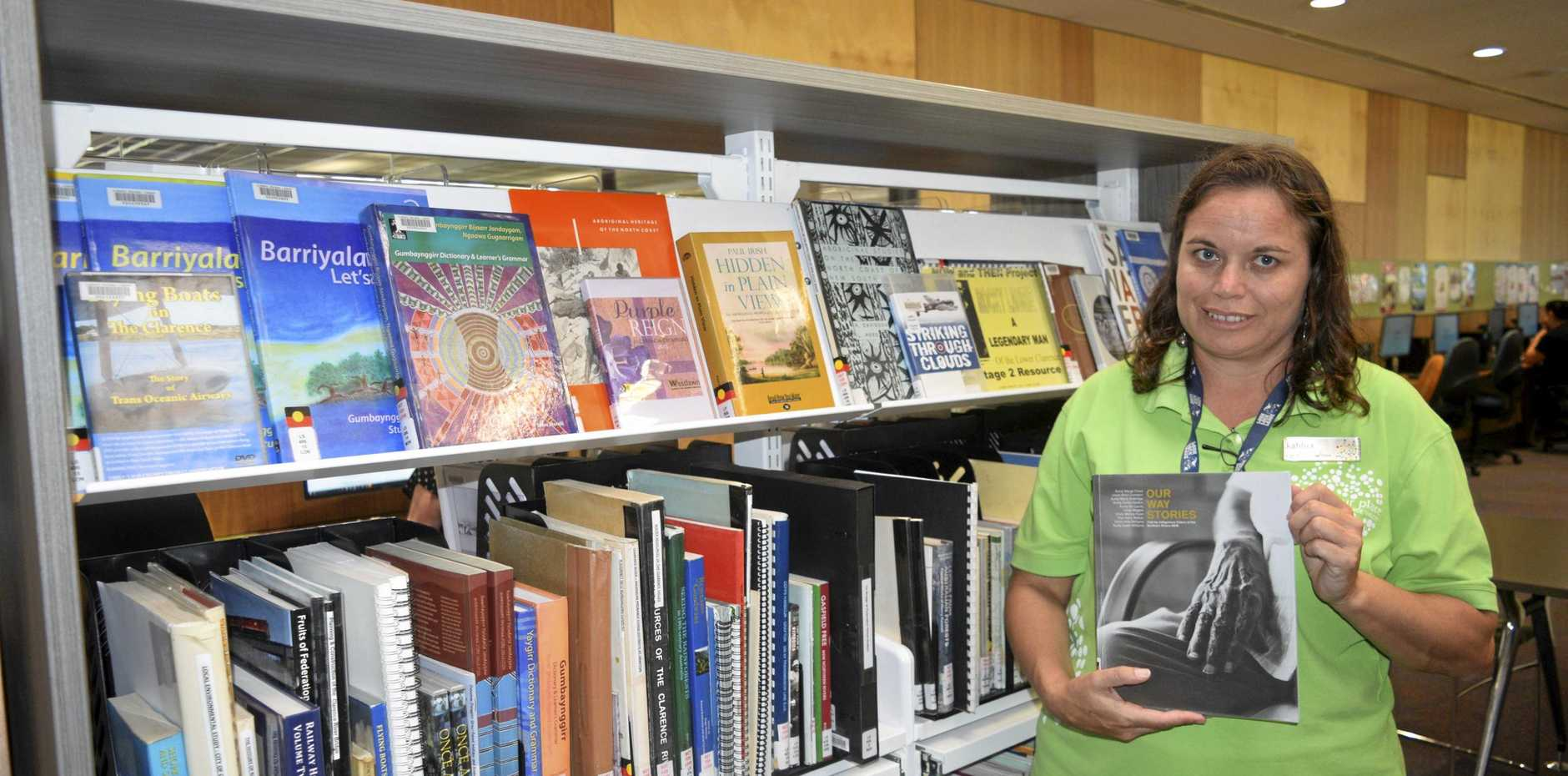 IMPORTANT RESOURCE: Clarence Regional Library assistant and Yaegl woman Kahlua Charlton checks out some of the titles in the Indigenous section at the Grafton library.