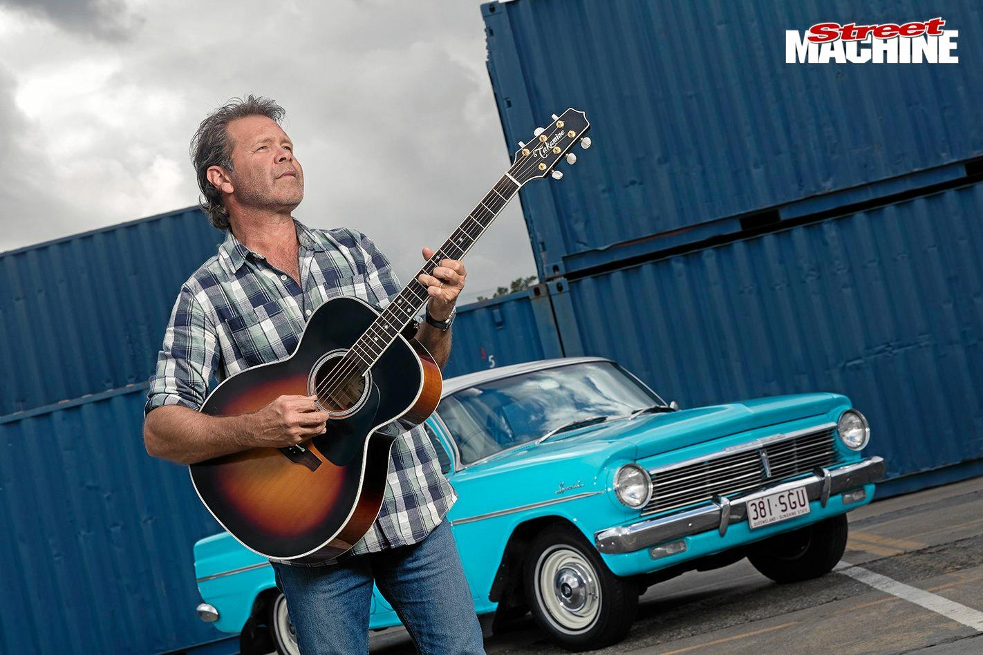 Troy Cassar-Daley wrote the song 'Shutting Down Our Town' for Barnes after reading his memoir Working Class Man. Cassar-Daley is pictured with his pride and joy his classic EH Holden.