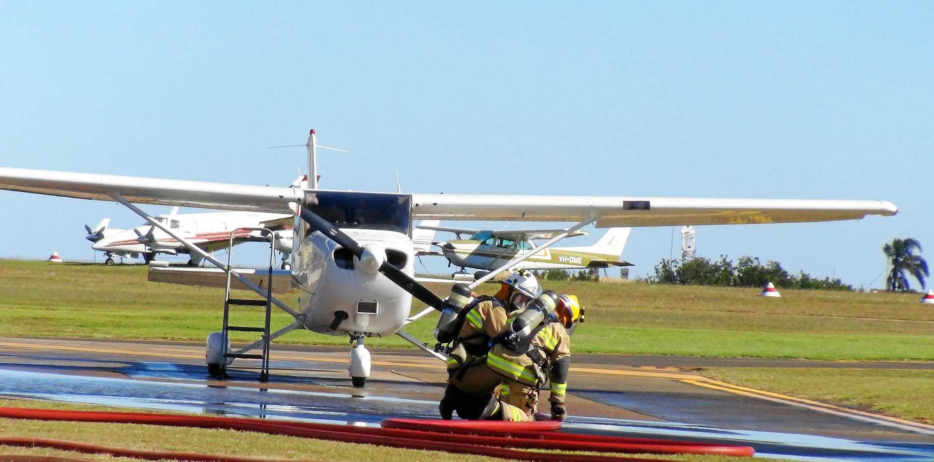 EMERGENCY PROCEDURES: Queensland Fire and Emergency Services officers take part in a simulated aircraft refuelling fire at the Toowoomba aerodrome yesterday.