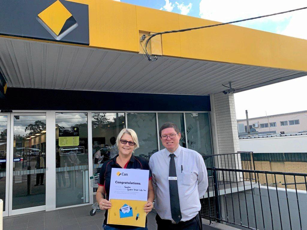 CHARITY BOOST: Helen Youngberry, of Goodna Street Life, accepts a donation from CBA Goodna branch manager Jason Ng.