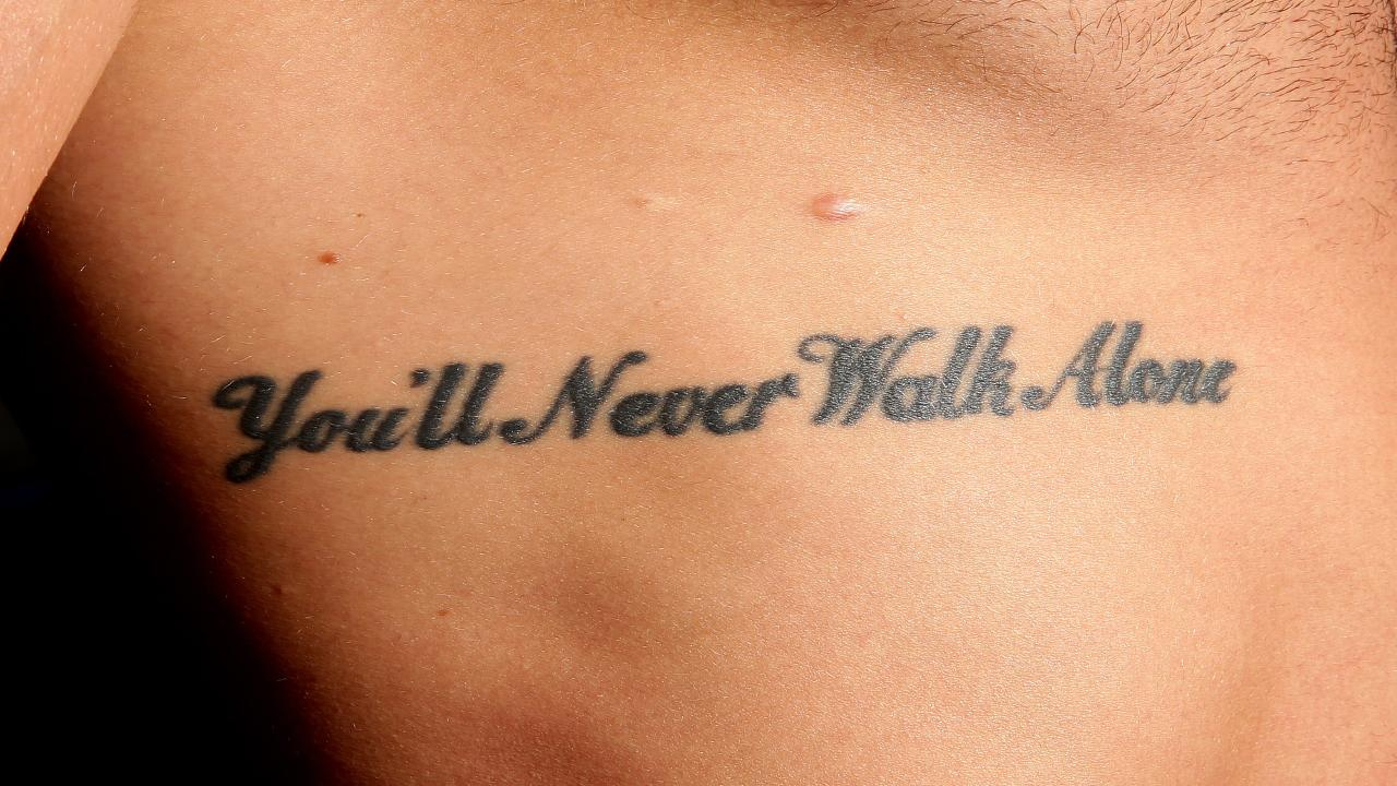 """You'll Never Walk Alone"" tattooed on Robbie Farah's ribs. Picture: Gregg Porteous"