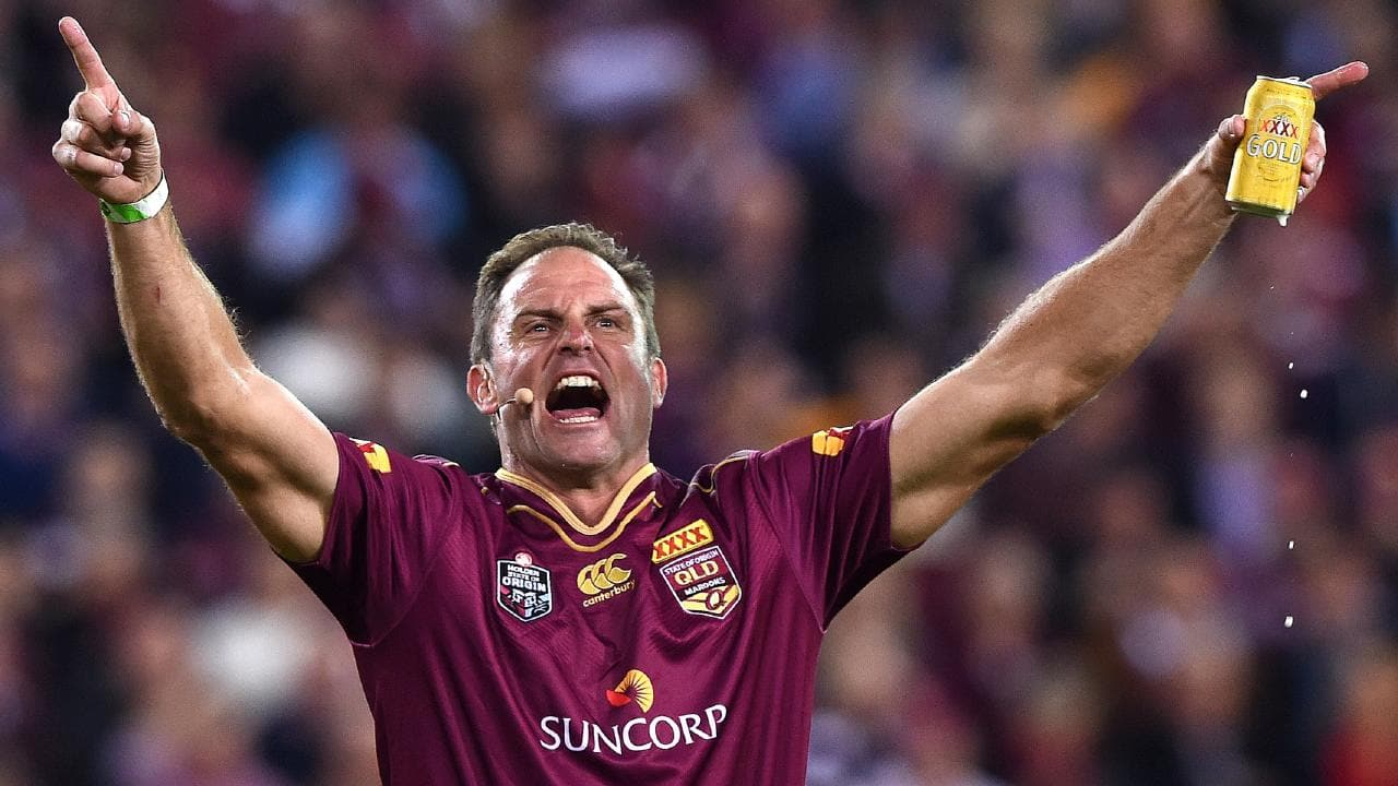 "Billy Moore fires up the crowd with the ""Queenslander"" chant in 2016, naturally clutching at a XXXX can. Picture: AAP Image/Dave Hunt"