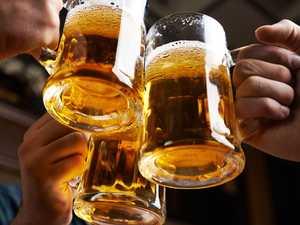 Beer drinkers help truckie with stuck road train