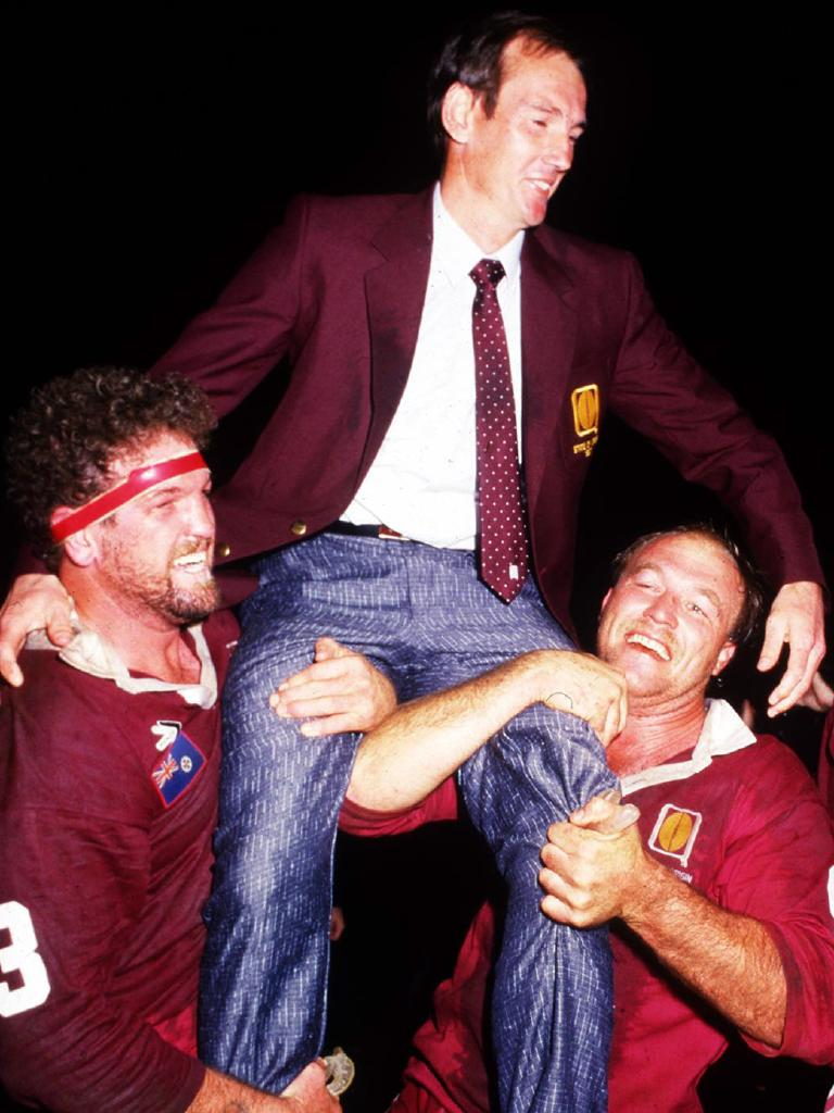Greg Dowling and Wally Lewis lift Wayne Bennett onto their shoulders after winning Game One in 1987.