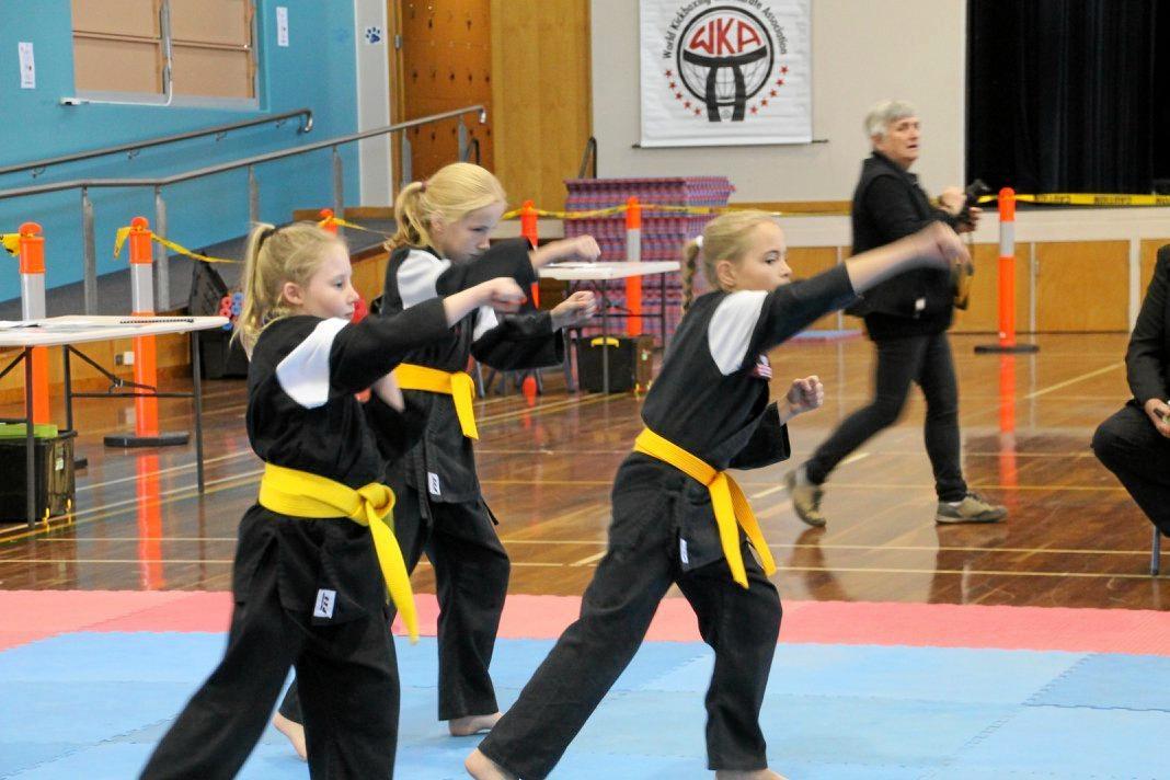 ON SONG: Georgie Denny, Charlotte Ballard and Mia Ballard prepare for the synchronised kata competition.
