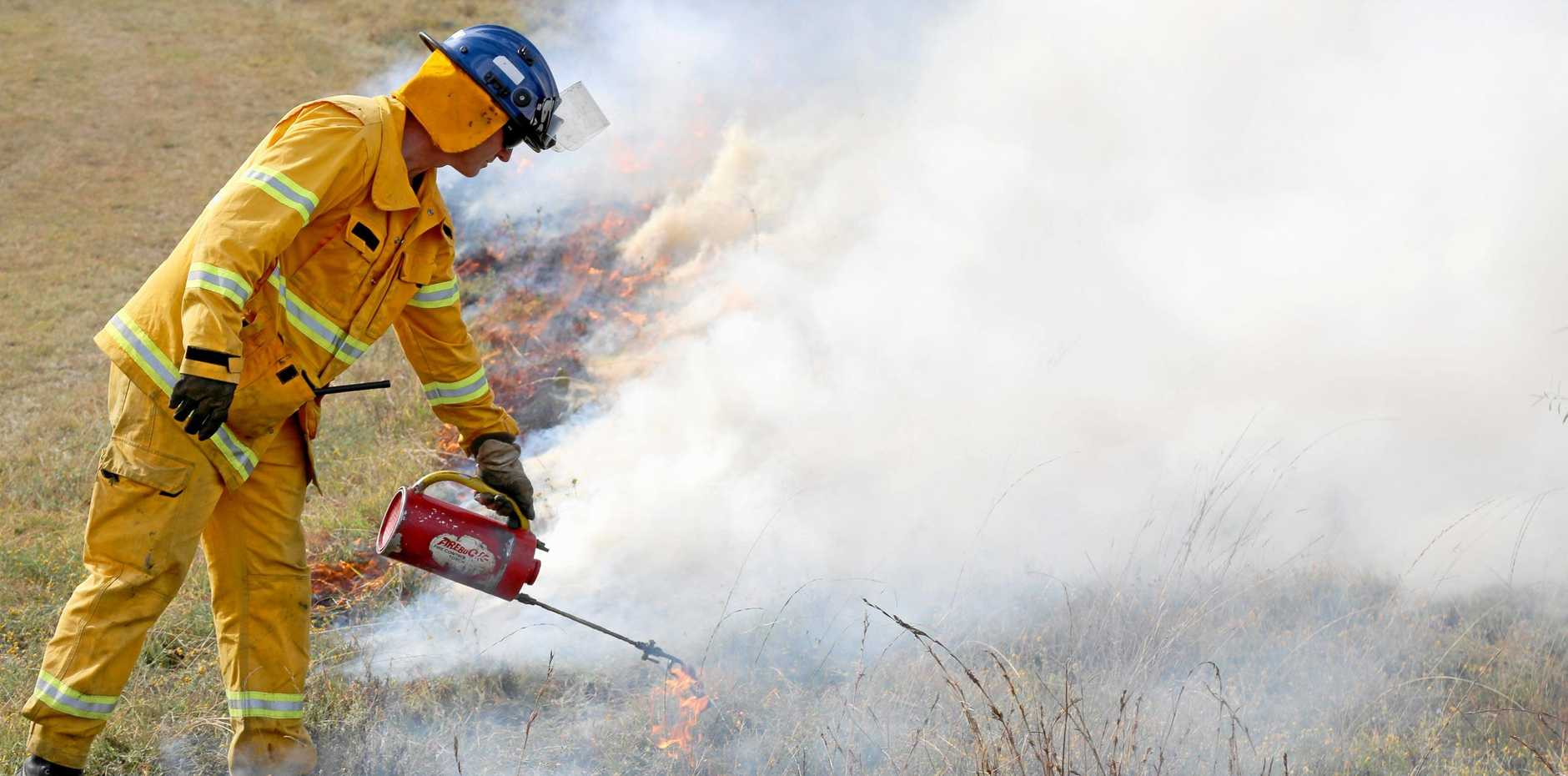 Seqwater Recreation and Catchment Operations Supervisor Matthew Wellington takes part in planned burn.