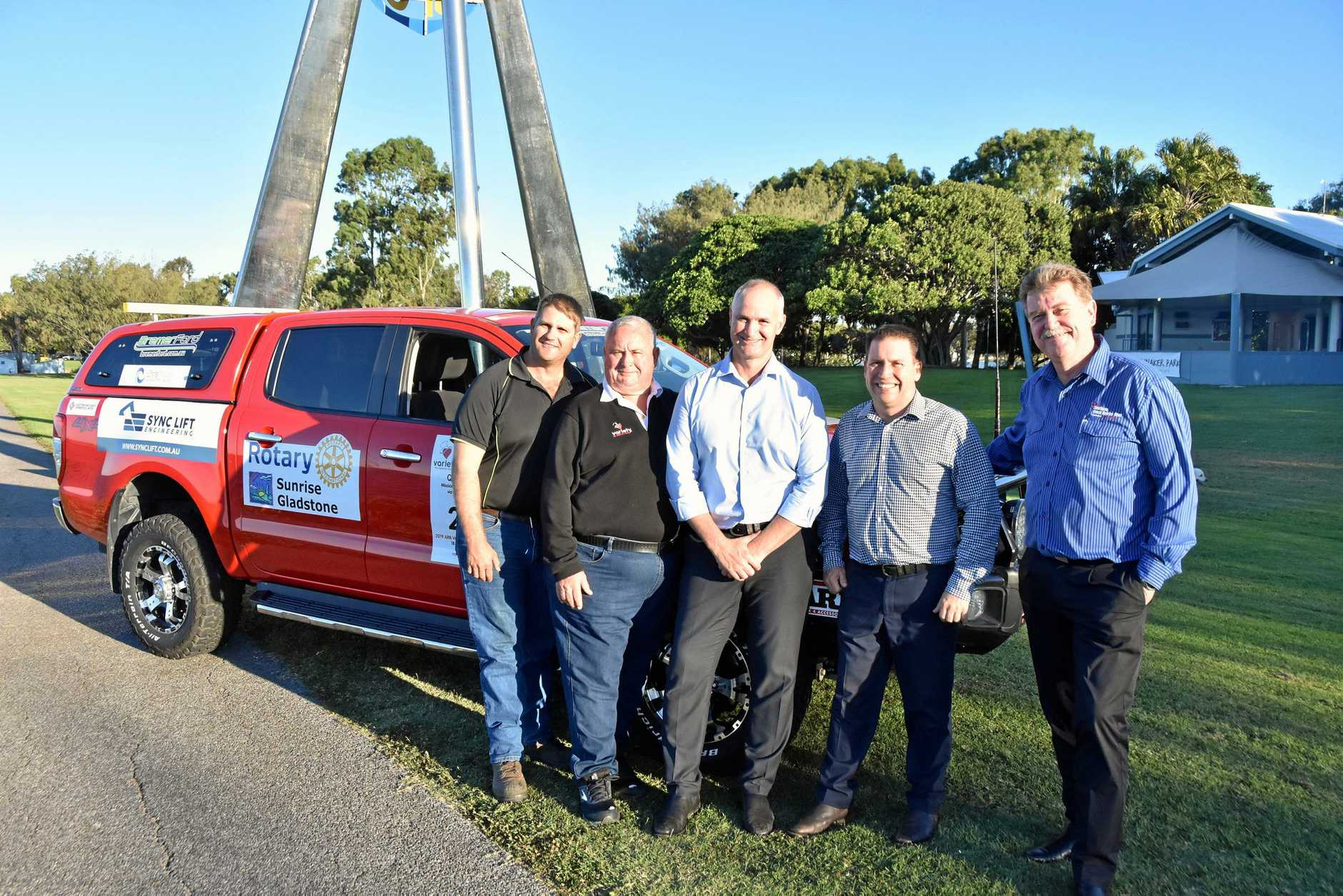 CASH FOR BASH: Kelvin Dennis of Dennis Contracting Services, Greg Klease, Gladstone MP Glenn Butcher, Mayor Matt Burnett and Darryl Branthwaite of GAPDL next to the Variety 4WD Car #27 ahead of the 2019 ARB Variety 4WD Adventure.