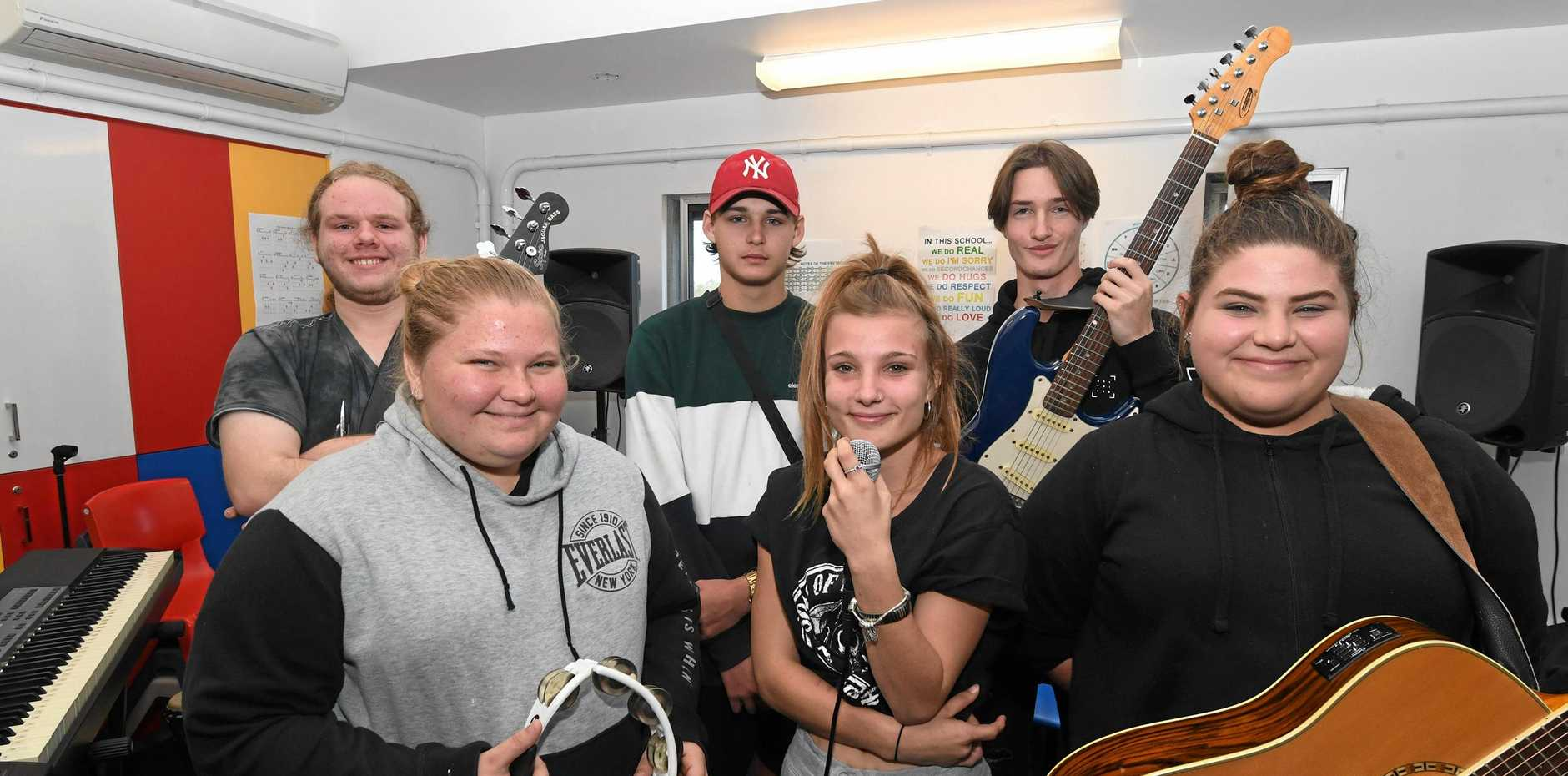NEW ROCKSTARS: Keen to compete in the AICM Band Showdown next month are (back from left) Colin Cook, Saxon Cornwell and Nathan Hornery and (front) Sophie Stokes, Rose Whittaker and Kye Kelly from the Flexible Learning Centre.