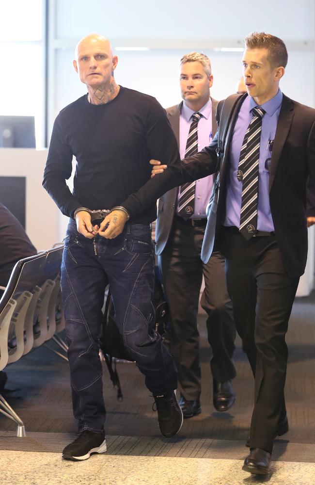 Nick the Knife Forbes being extradited from South Australia.