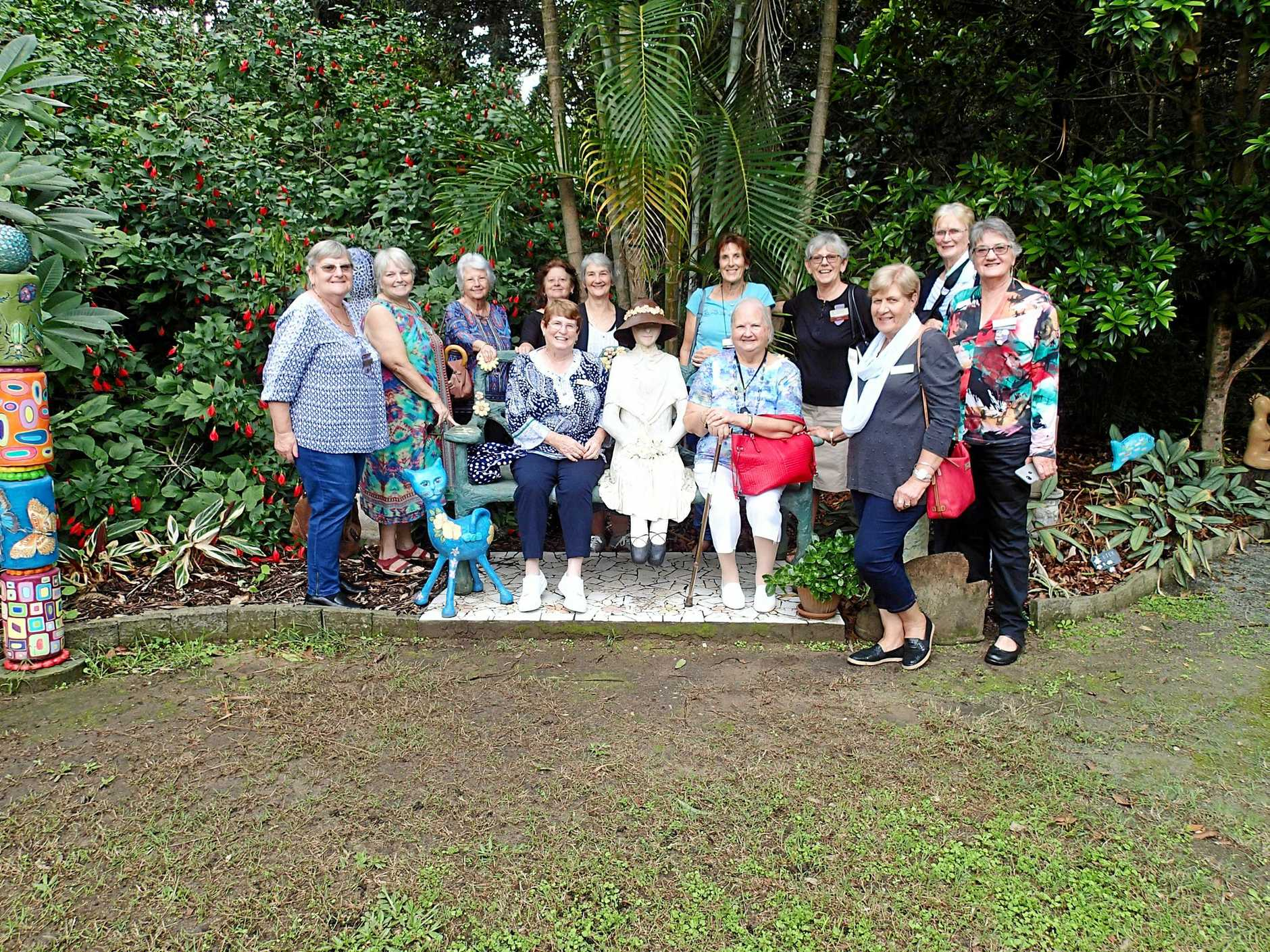 STRIKE A POSE: Pine Rivers VIEW Club ladies posing with some sculptures at the Sculpture Gardens, Deception Bay.