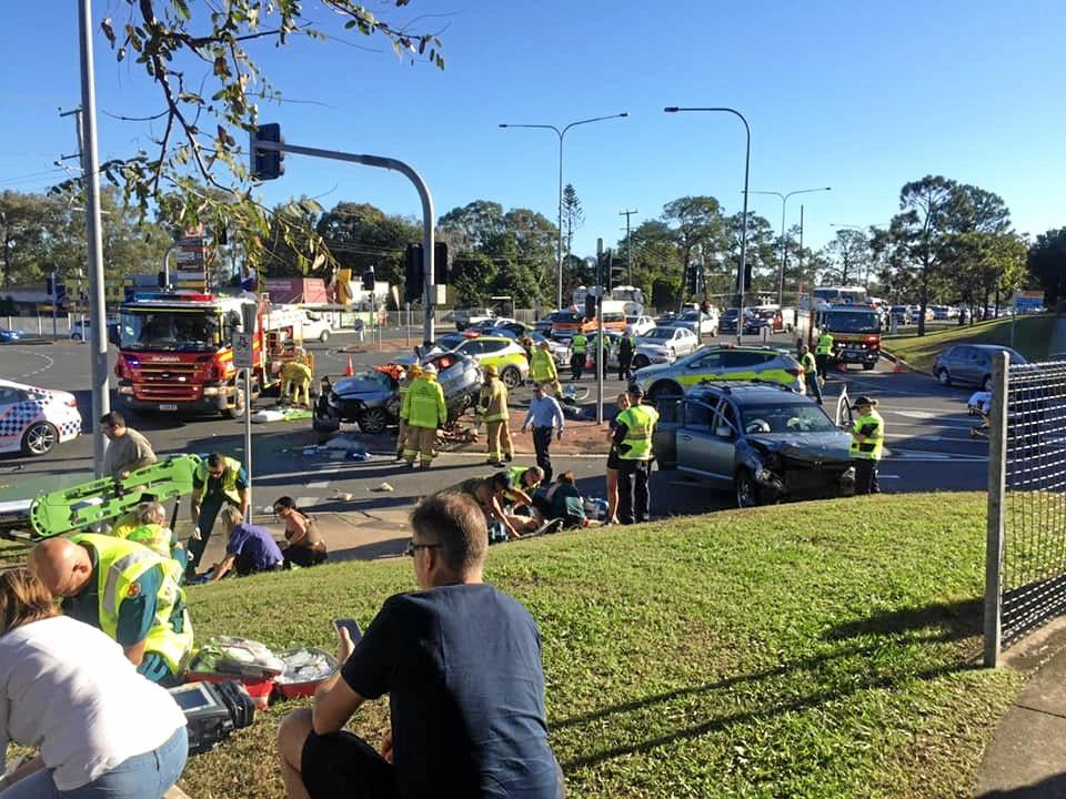 A person has died and two children have been seriously injured in a crash north of Brisbane that witnesses described as the stuff nightmares are made of, with motorists warned to avoid the area.