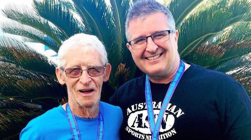 STRONG: Derek Mason, 80, is a world record holder, with coach John Ross.