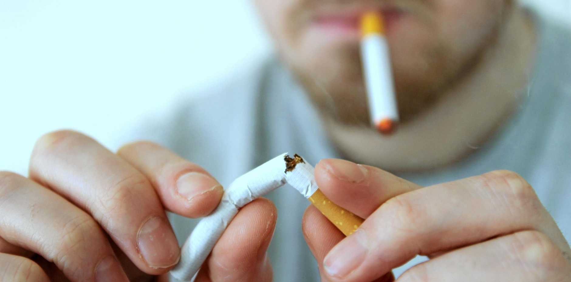 TIME TO QUIT: Dr Margaret Young (inset) says the Wide Bay has a far higher smoking rate than the state average.