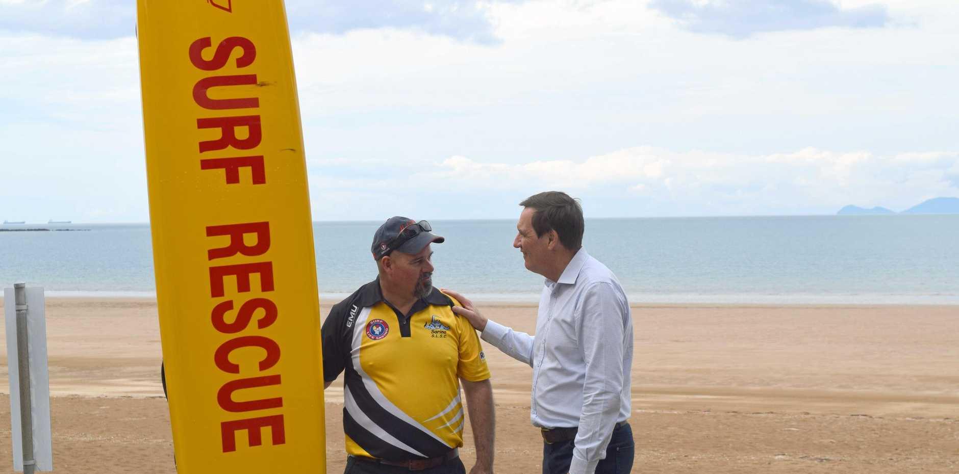 Sarina SLSC president Neil John and Energy minister Anthony Lynham at Sarina Beach.