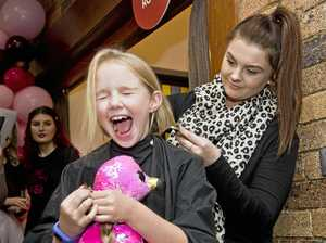 GALLERY: Girl cuts hair for charity at Colour of Change