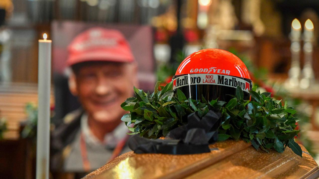 Niki Lauda's helmet was placed on top of his coffin. Picture: Joe Klamar