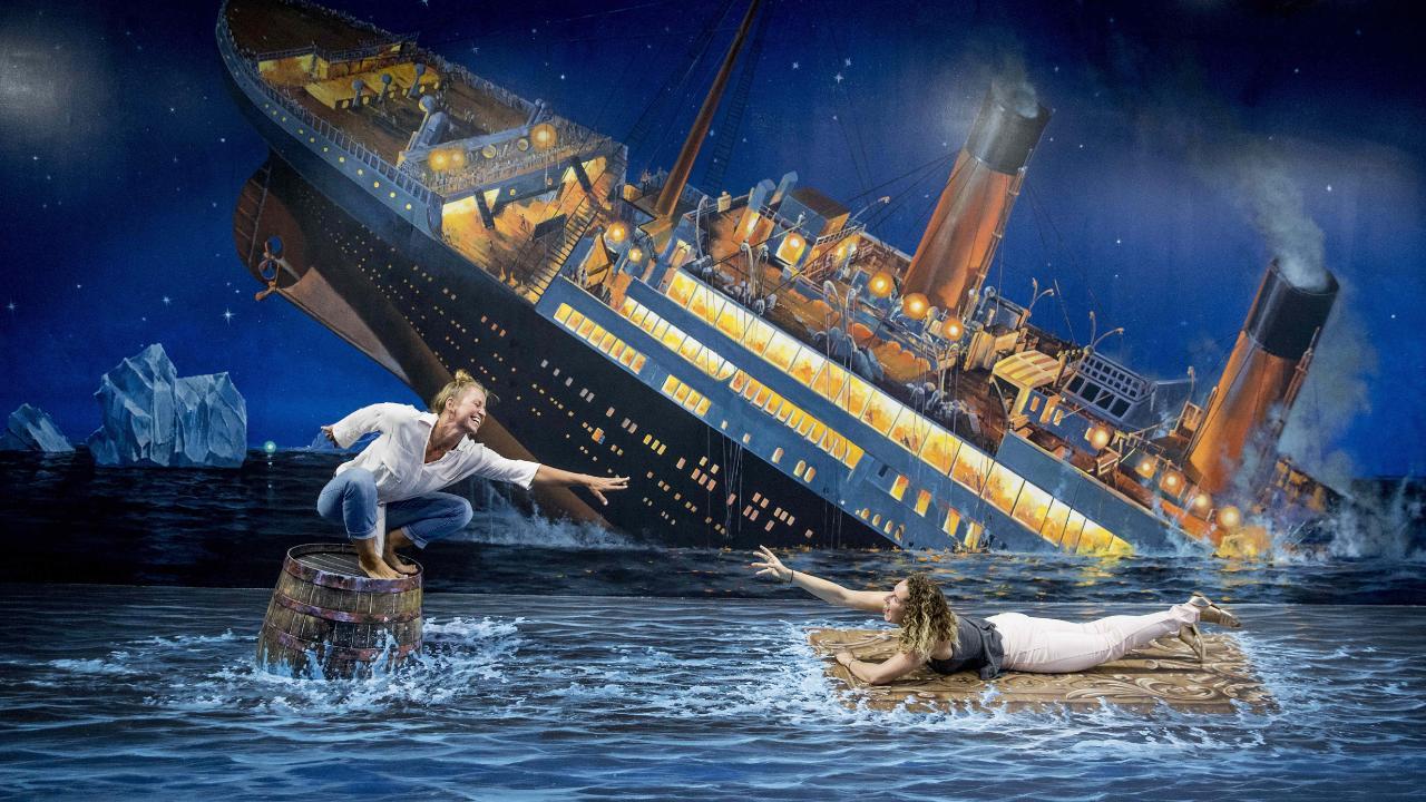 Iveta Rackova and Veronika Nentvichova do their best Titanic re-enactment at the Coast's new 'trick-art' gallery, ArtVo Illusion at Robina Town Centre. Picture: Jerad Williams