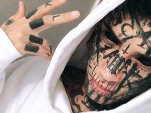 Tattooed fugitive taunts cops