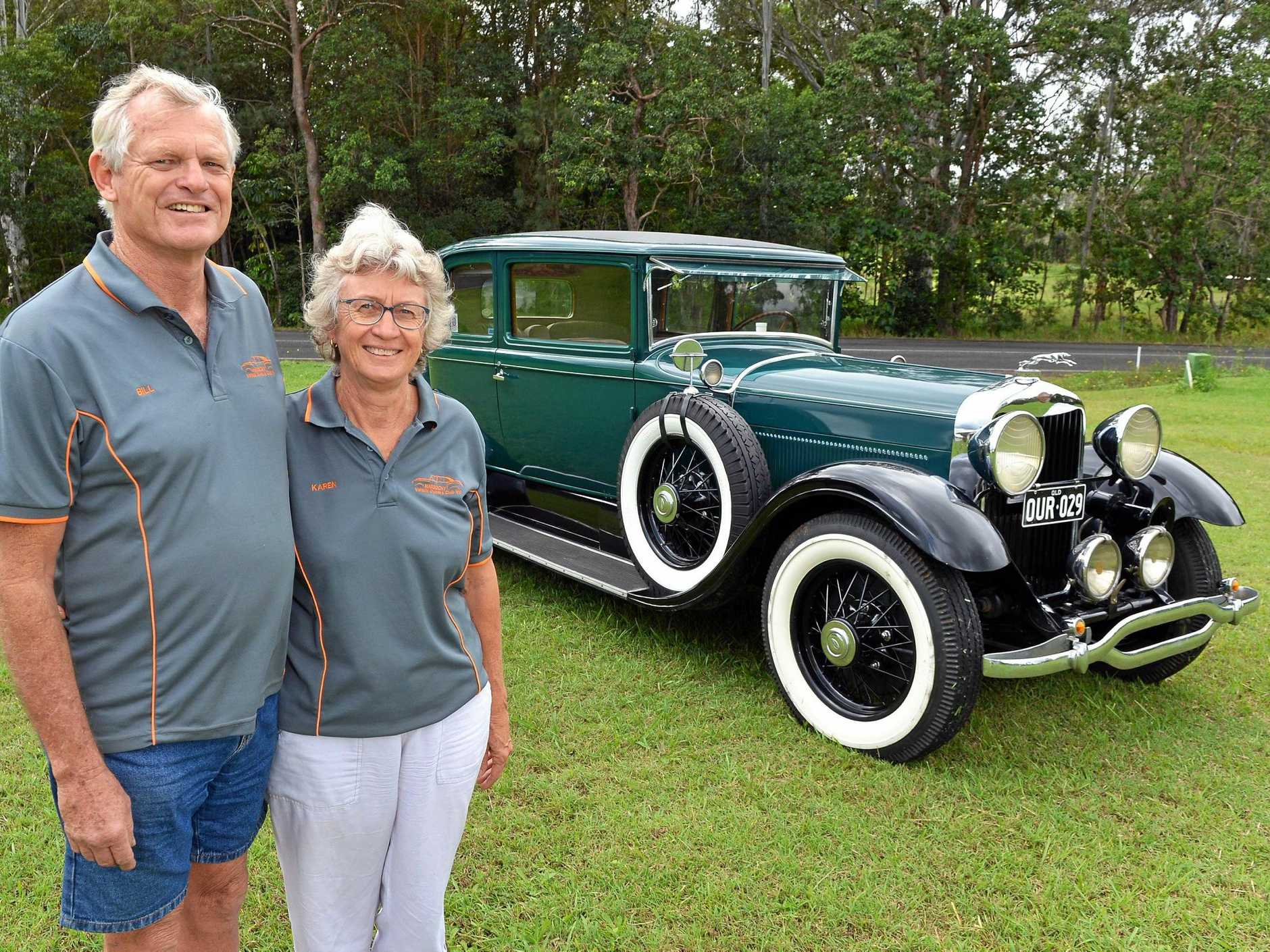 A PENCHANT FOR RESTORATION: Bill and Karen Ryan with their 1929 Lincoln 5 Passenger Coupe.