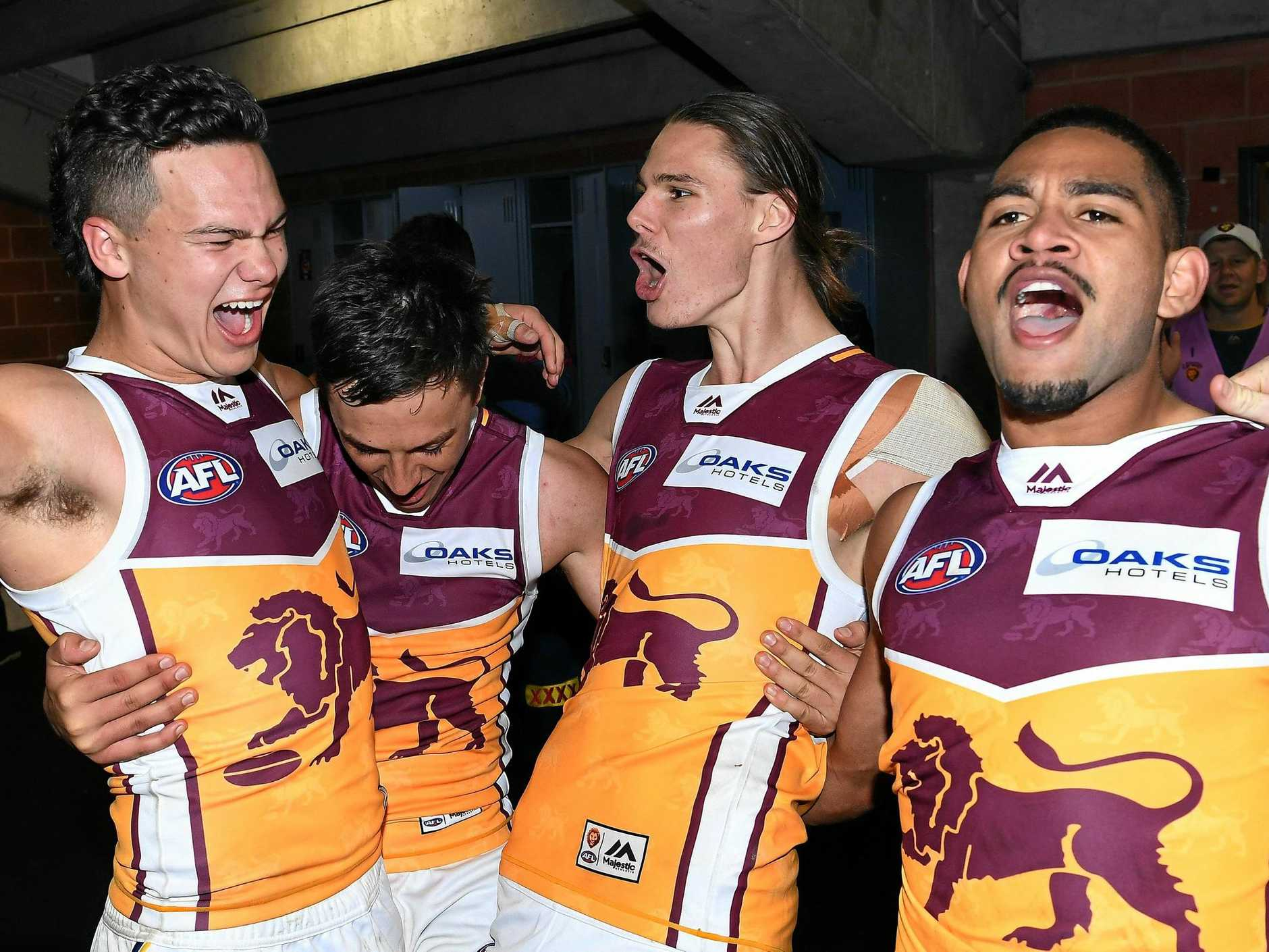 The Lions' Cameron Rayner, Hugh McCluggage, Eric Hipwood and Cedrix Cox enjoy the moment after Brisbane's win over Hawthorn in round 17 last year. Picture: Julian Smith/AAP