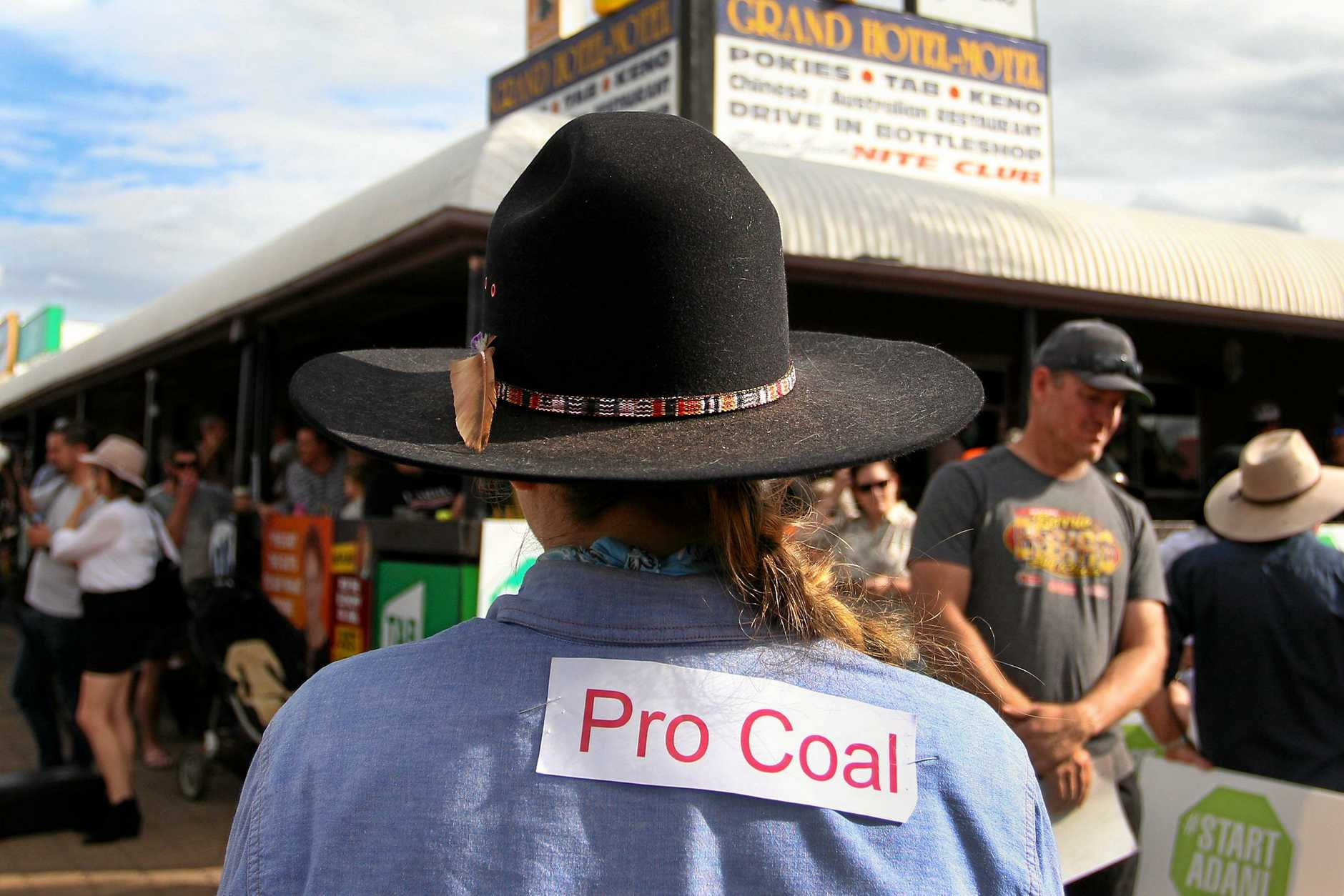 CLERMONT, AUSTRALIA - APRIL 27: A young pro-Adani supporter wears a 'Pro Coal' sign on her shirt on April 27, 2019 in Clermont, Australia. Former Greens leader and conservationist, Bob Brown, has been leading a convoy of environmental activists through the Southern States towards Central Queensland as part of the #StopAdani movement. With primary concerns for increased coal ship travel through the Great Barrier Reef World Heritage Area, unlocking of the Galilee Basin and increase in carbon pollution. The proposed Adani Carmichael Mine, if approved will be constructed in the North Galilee Basin, 160kms north-west of regional town Clermont, its first stage is estimated to produce 27.5 million tonnes of coal per annum and will be transported via rail to Abbot Point which is situated 25km north of Bowen.